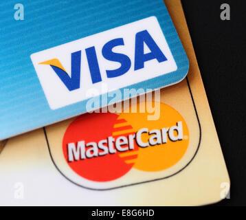 Tambov, Russian Federation - September 11, 2012 Visa and Mastercard logos on credit cards. Black background. Studio - Stock Photo