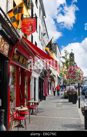 Shops and cafe on the High Street in the town centre, Kilkenny City, County Kilkenny, Republic of Ireland - Stock Photo