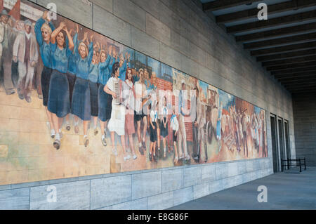 East German communist propaganda mural on wall of Finance Ministry - Stock Photo