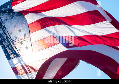 United States flag flying from a fire truck ladder in Barnstable, Massachusetts, USA.
