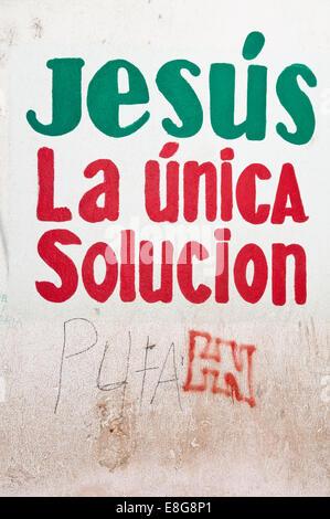 Jesus, the only solution painted sign on wall, in Spanish, San Pedro La Laguna, Lake Atitlan, Guatemala - Stock Photo