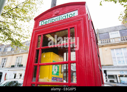 A telephone box in Cheltenham, UK, which now contains a defibrillator instead of a telephone - Stock Photo