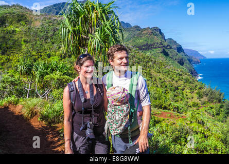 Hikers with baby on the Kalalau Trail in Kauai - Stock Photo