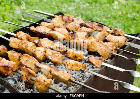 skewers of fried chicken on the grill - Stock Photo