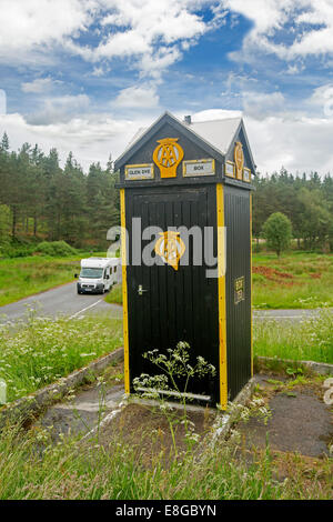 Motorhome by heritage listed British Automobile Association (AA) phone box at isolated road junction Glen Dye Scottish - Stock Photo