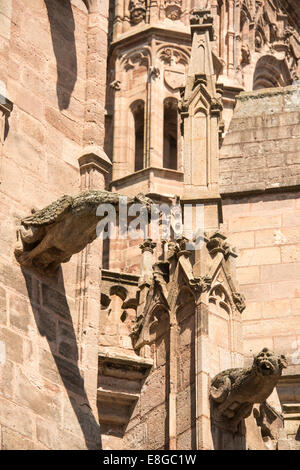 Gargoyles on the upper walls of the 13C red sandstone Cathedral of Notre Dame in Rodez Aveyron France