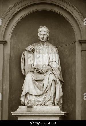 Statue of Arnolfo Di Cambio, Italian architect and sculptor, by Luigi Pampaloni, outside the Uffizi Gallery, Florence, - Stock Photo