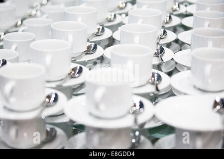 A lot of cups and saucers waiting for hot drinks at a conference - Stock Photo
