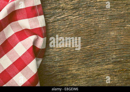 the red tablecloth over old wooden table - Stock Photo