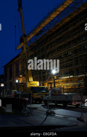 Work progresses through the night on repairs to the Mackintosh Building of Glasgow School of Art. - Stock Photo