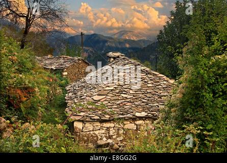 Old stone houses at Argyro Pigadi village, Oreini ('mountainous') Nafpaktia, Aitoloakarnania, Greece. - Stock Photo
