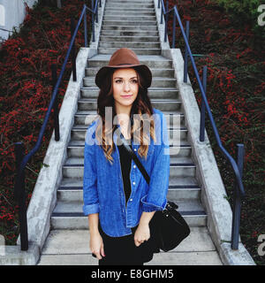 USA, Portrait of young woman wearing hat Stock Photo