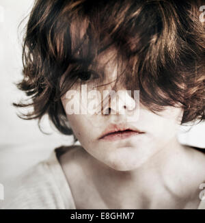 Norway, close-up of girl looking tired and sad - Stock Photo