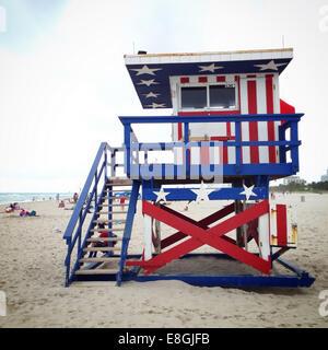 Stars and stripes on lifeguard hut, America, USA - Stock Photo