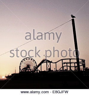 Fair ground at sunset - Stock Photo