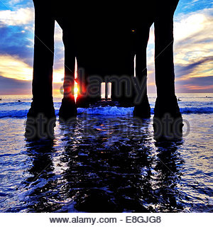 View of pier at sunrise - Stock Photo