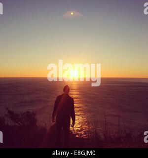 Man looking at sunset view, Muir Beach, California, United States - Stock Photo