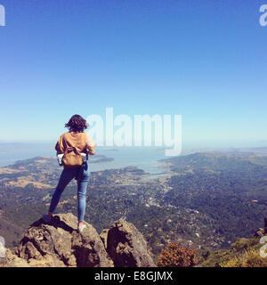 Woman standing on Mount Tamalpais looking at city, San Francisco, California, United States - Stock Photo