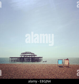 UK, England, East Sussex, Brighton, Two deck chairs on Brighton Beach
