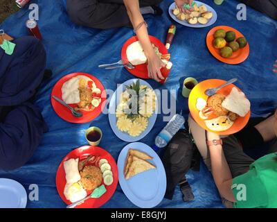 Indonesia, West Nusa Tenggara, Mataram, Mount Rinjani, Outdoor picnic - Stock Photo