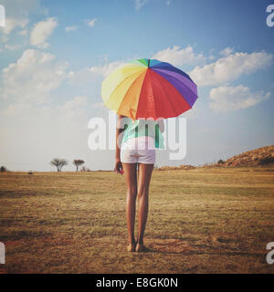 South Africa, Gauteng, Johannesburg, Roodepoort, Lady with Rainbow Umbrella - Stock Photo