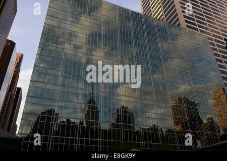 USA, New York State, New York City, Reflection of Empire State Building and skyline in building facade - Stock Photo