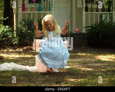 Statesville, Iredell County, North Carolina, United States of America Swinging Happily - Stock Photo