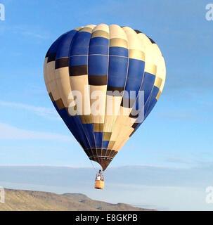 Hot air balloon flying over the mountains, Texas, USA - Stock Photo