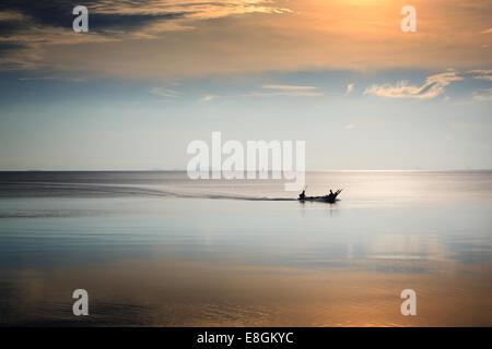 Malaysia, Johorm, Muar, Tanjung Mas, Fisherman in boat - Stock Photo