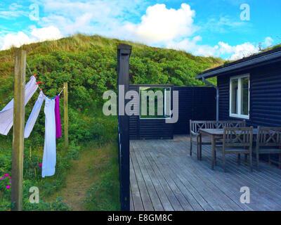 Towels hanging on washing line outside summerhouse, Fanoe, Denmark - Stock Photo