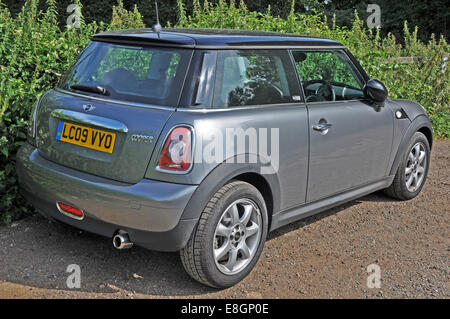 2009 GB registered, iconic, classic design, Mini Cooper (manufactured by BMW). The car is parked and unoccupied - Stock Photo