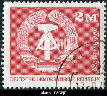 Postage stamp printed in Germany, shows the coat of arms of the German Democratic Republic - Stock Photo