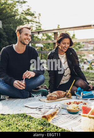 Happy friends enjoying rooftop party - Stock Photo