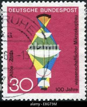 Postage stamp printed in Germany, dedicated to the 100th anniversary of scientific microscope construction - Stock Photo