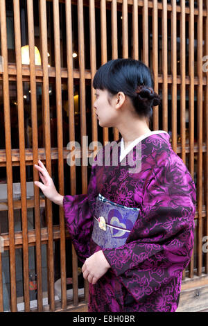 Young Japanese Girl In A Kimono - Stock Photo