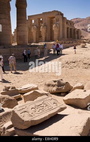 Egypt, Luxor, tourists in Ramesseum, Mortuary Temple of Ramses II - Stock Photo