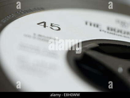A vinyl single 45rpm in selective focus - Stock Photo