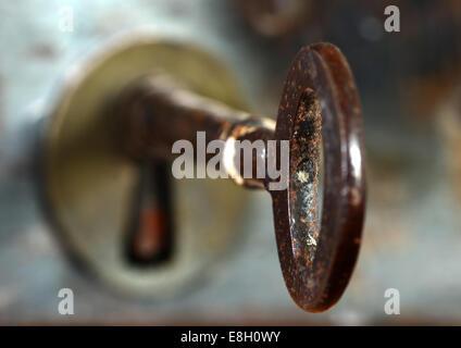 Old key in a door lock - Stock Photo