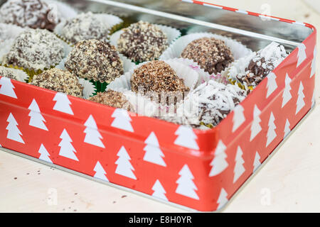 Homemade chocolate truffles with different coatings such as coconut, crushed almonds or hazelnuts or walnuts. Each - Stock Photo