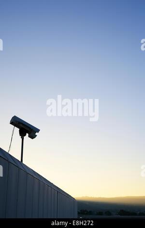 USA, California, San Francisco, CCTV camera in evening sky - Stock Photo
