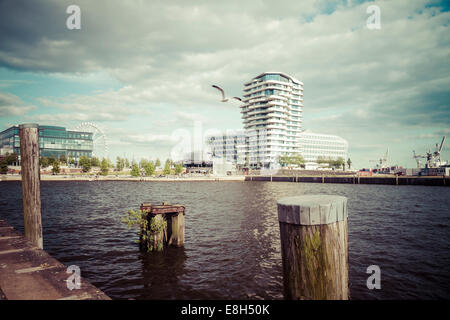 Germany, Hamburg, HafenCity, Grasbrookhafen, Marco-Polo-Tower and Unilever House - Stock Photo