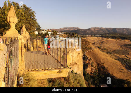 Ronda Spain the town sits on top of tall cliffs giving spectacular views across the  nearby Sierra de Grazalema mountains