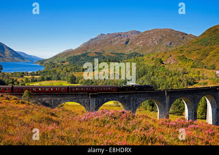 Jacobite Steam Train crossing Glenfinnan Viaduct, Lochaber, Scotland, UK - Stock Photo