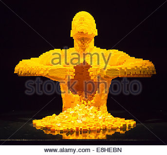 The Art of Brick exhibition show, Nathan Sawaya Lego figures sculptures statues modern iconic Yellow 11014 bricks - Stock Photo