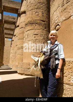 Egypt, Luxor, Karnak Temple, senior female tourist amongst columns of Great Hypostyle Hall - Stock Photo