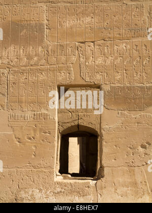 Egypt, Luxor, Ramesseum, Mortuary Temple of Ramses II, wall filled with hieroglyphics - Stock Photo