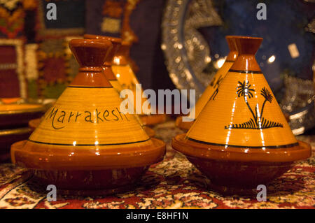 Horizontal close up of traditional earthenware tagines on sale in the souks of Marrakech. - Stock Photo
