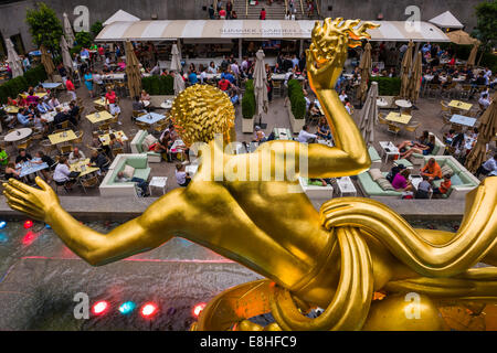 The statue of the Titan God, Prometheus sits above the sunken plaza at the Rockefeller Center located in Midtown - Stock Photo