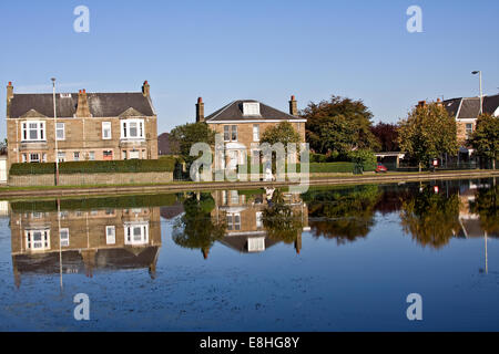 Crisp and clear colourful Autumn reflections on Swannie Pond in Dundee, UK - Stock Photo
