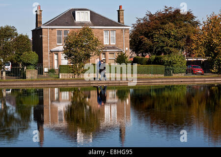 Crisp colourful Autumn water reflections on Stobsmuir Ponds in Dundee, UK - Stock Photo